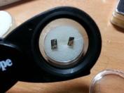 Andalusit tillhör de mest pleokroiska material som finns och det är lätt för en gemmolog att med ett enkelt test skilja andalusit från liknande material.