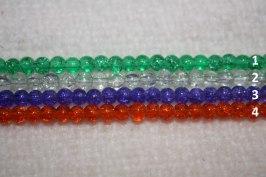 Olika färger på krackelerade glaspärlor. 1. Grön  2. Transperant  3. Blålila  4. Orange