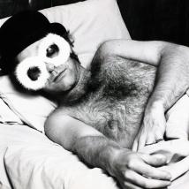 Elton John in his bed in London