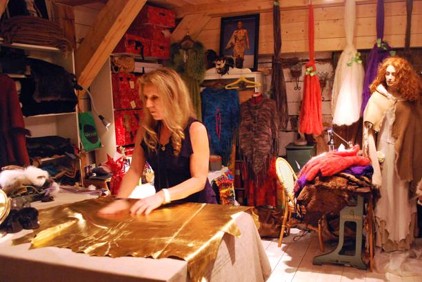The designer Eliza is working in her studio