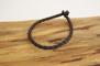 Rundflätat svart läderarmband - 23,5 cm