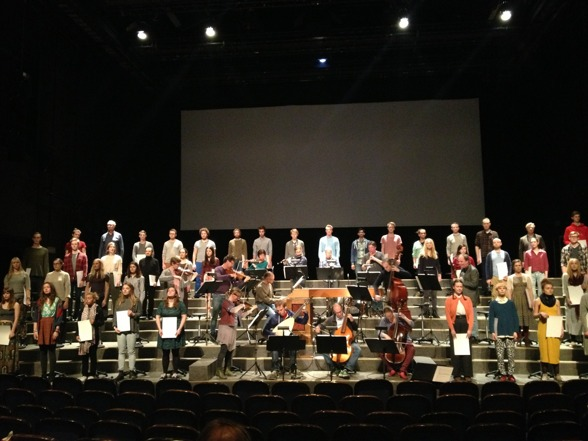 Full ensemble on stage during rehearsal!
