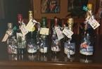 7 flaskor Champagne med foton på varje häst !! Ett för varje OS.