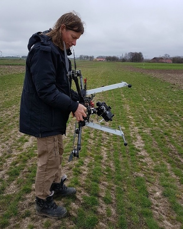 Fig. 3. Calibration of the Downwelling Light sensor at Lönnstorp. Per-Ola had to rotate the UAV in different ways according to the Micasense application (connected via WIFi to the cellphone). Photo by Ximena Tagle.