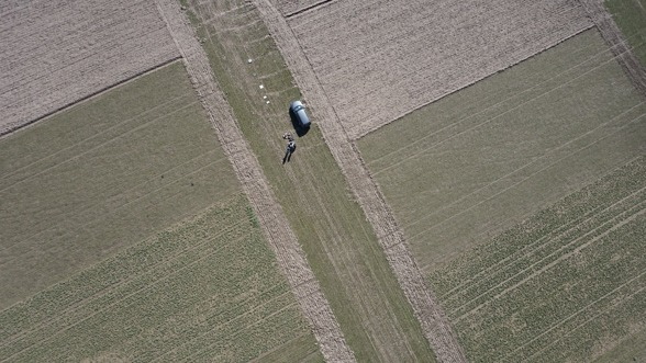 UAV flying over fields and reflectance panels on March 13th 2017. Image taken from the Sony camera on-board of the UAV.