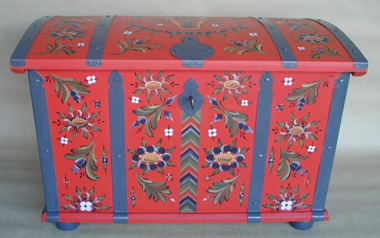 Brides chest in a warm base colour from 1800 with the handmade metal fittings in blue. Wood work by S. Pounu