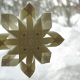 Advent Star in retro style. The star is made of  wool (100%), lamp shade plastic and metal parts.