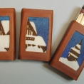 """Box of matches in reindeer leather with  """"Kiruna church"""" in handprinted wool."""