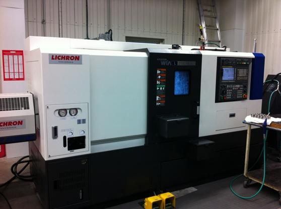 Hundai WIA L210LMSA, Automatic turning machine with bar feeder and sub spindle