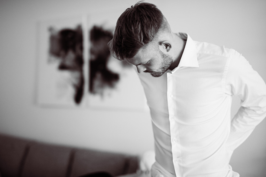 Groom is getting ready for wedding. Photo by Rebecca Wallin