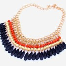 Tassel-halsband i orange, vitt & svart
