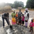 Women group providing water 2