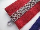 Detaljröttlinnearmband