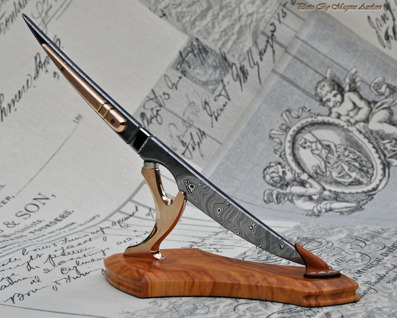 Coop's Desk Scalpel - Damasteel blade with bronze details and Olivewood base.
