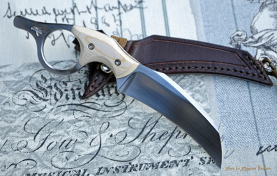 Ringed Claw -  Neck knife in 12C27 and micarta.