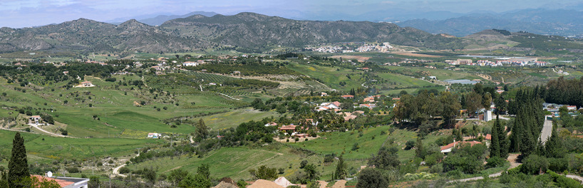 View of the beautiful, flat valley between the Mijas Mountains and the mountains further inland