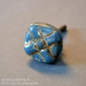 Knopp Flätad blå
