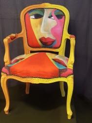 Karina gör stolar som konstverk. Tyg designat av  Cecilia Bertling.