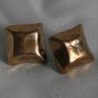 Bosetter gjutna i brons