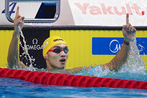 XU Jiayu vann 100m ryggsim