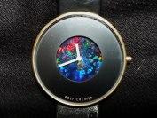 Armbandsur med urtavla tillverkad av en svart Australiensisk Opal.