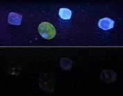 Diamanter under långvågigt uv ljus överst respektive kortvågigt på den nedre.
