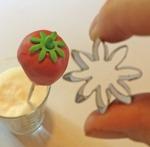Utstickare Daisy för detalj på jordgubben