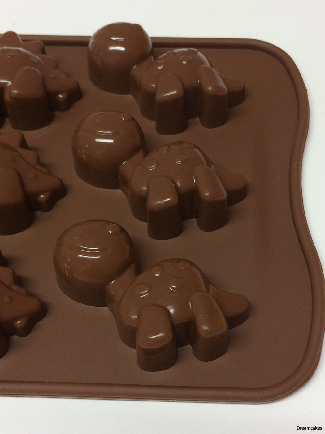 Pralinform, chokladpraliner, dinosauriegodis, dinosaurier av choklad, gjut chokladpraliner i form av dinosaurier