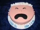 Tårta levererad till blivande mamma som arbetade som lärare. Tårta täckt med marsipan.