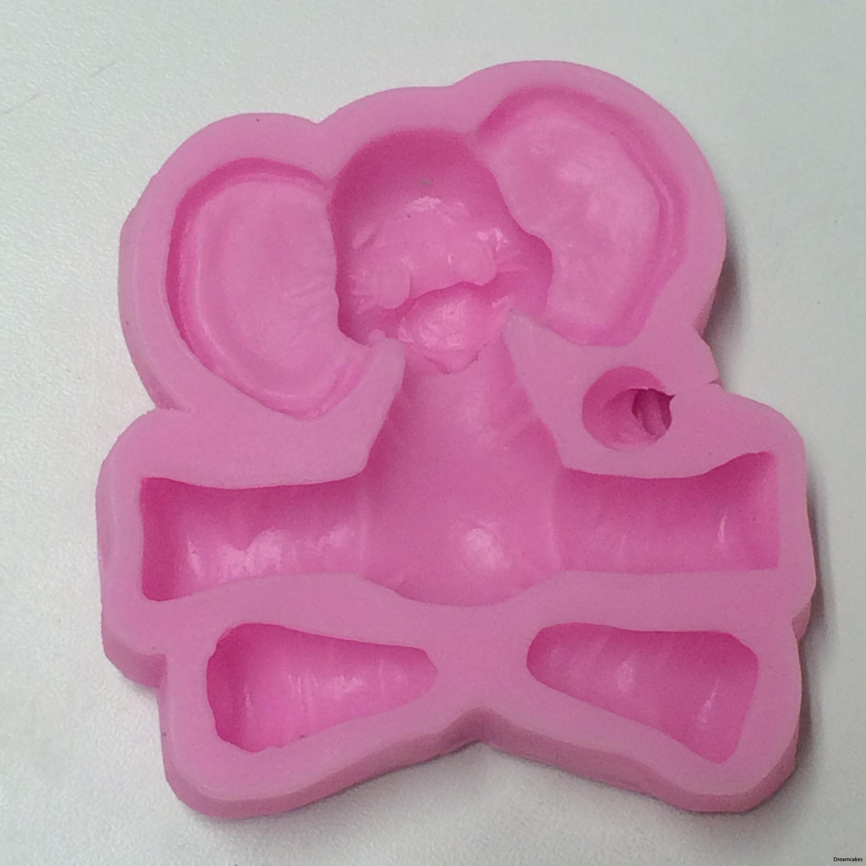 Gjutform för fondant eller sockerpasta till barnkalaset eller doptårta