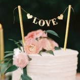 Tårtdekoration - Love i guld