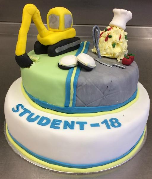 Studenttårta för en kock och en grävmaskinist