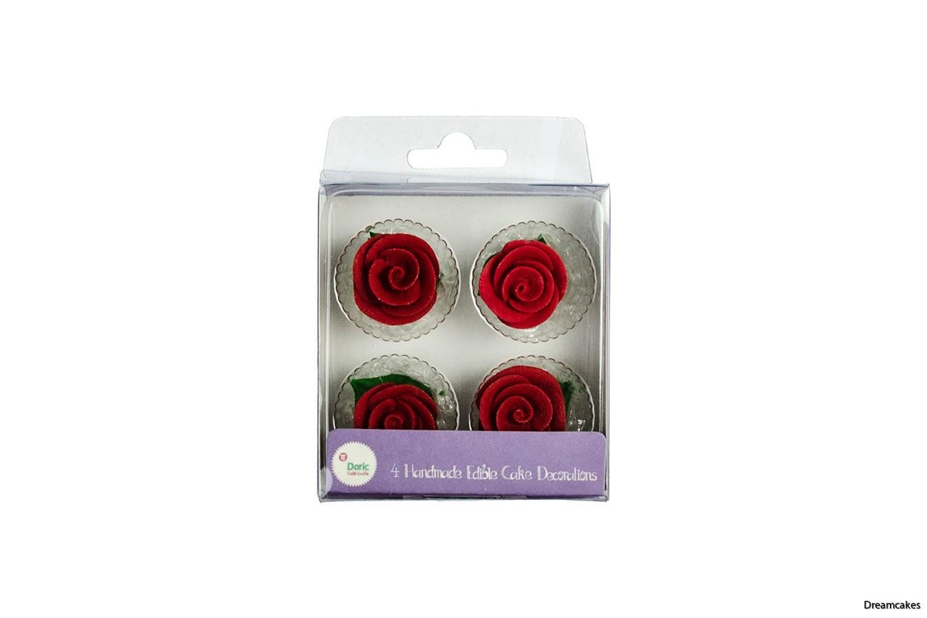 Spritsade ätbara rosor för tårtan
