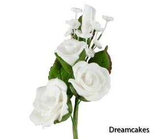 Tårtblommor i vit rosbukett av socker