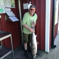 Stig Augustsen, lax, 10,3 kg och 99 cm lång. Fångad den 9/5 på Rökeriet .