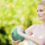 Girl Holding Green Ball