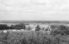 Borrestad smedja sett från åsen - vid skogsbrynet bortom de långa gårdlängorna