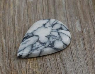 Pinolith handpolerad sten, 30x22mm