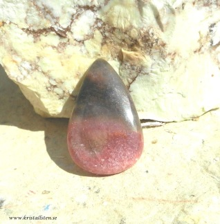 Rodonit  sten 37x24mm cabochon