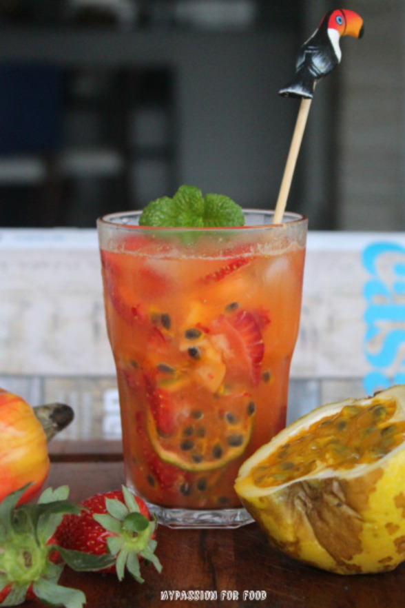 Caipirinha with strawberries, passion fruit and lime