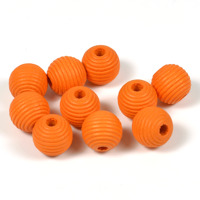 Räfflade träpärlor orange, 10mm