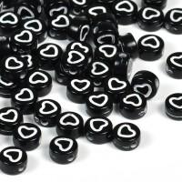 Svarta pärlor med hjärt-kontur