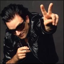 lynn goldsmith Bono studio Peace sign leather jacket smoking LOS ANGELES, 1992