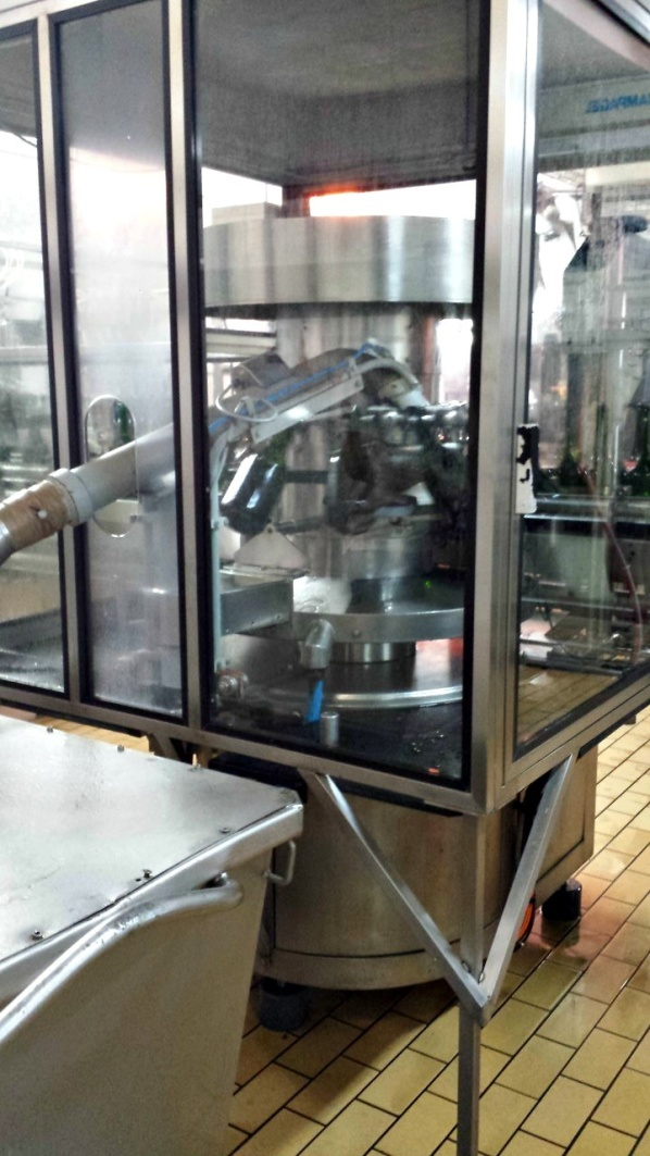 Degorgering och dosage (tillsättning av rätt mängd socker) maskinellt