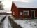 Förbi ladugård, magasin och garage mot söder