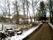 Ivarstorp från Ljungstorpsvägen. Där granen står låg tidigare Ivarstorps ladugårds västra inre gavel med rundtröskan på långsidan lite österut ut mot vägen, som då låg parallellt mer till höger i bild
