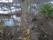 Dammen idag från vägen med bäcken. I bäcken fanns förr en skvaltkvarn.
