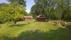 Ladugårds och gräsmatta från söder