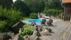 Trädgård, altan och poolområde integreras