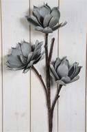 Grå Lotus på kvist Konstväxt